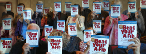 "Group holding up their copy of ""Beat Your A-Fib"""