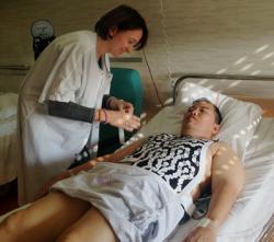 Dr. Haïssaguerre patient, Carlo Romero, as technician attaches ECGI vest